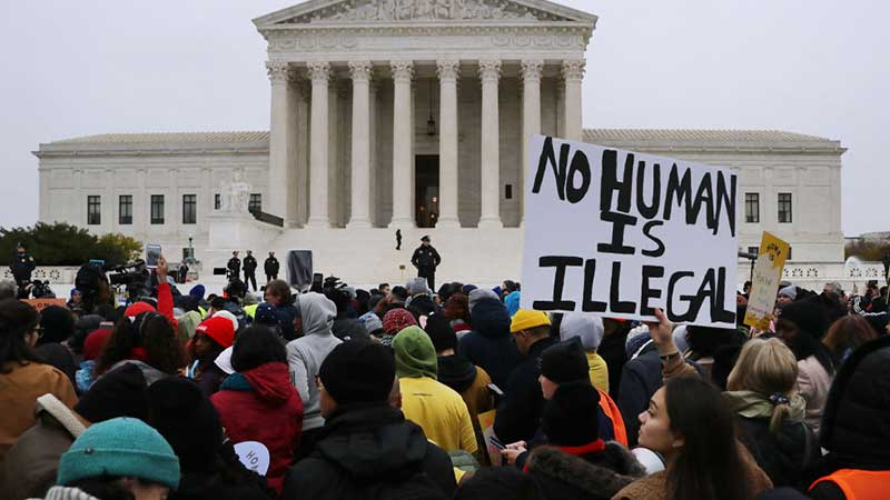 """Protesters outside white house. Sign: """"No Human is Illegal."""""""