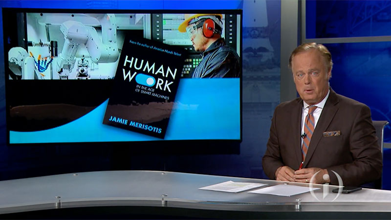 Inside Indiana Business Host Gerry Dick at the news desk with HUMAN WORK book cover keyed over his shoulder.
