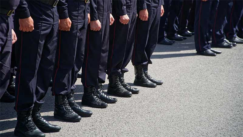 A line of boots, attached to aceless, uniformed neo-nazis.